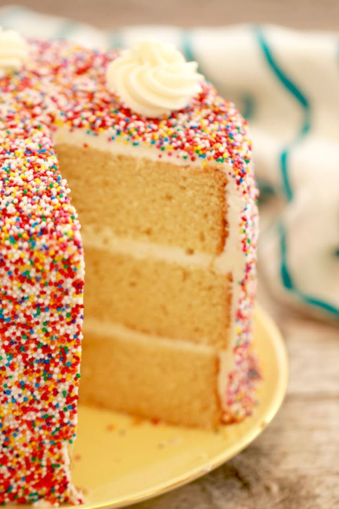 A slice of vanilla cake with sprinkles