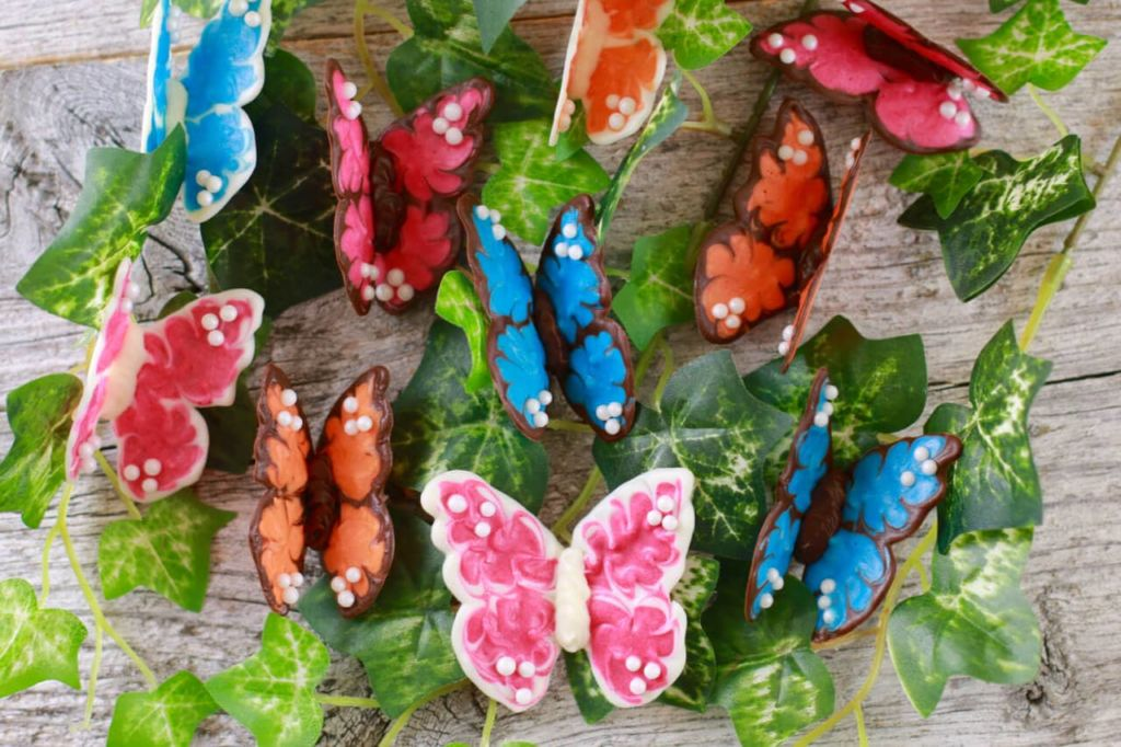 Chocolate Butterflies- Easy Cake decorating tips that people won't believe are made from chocolate.