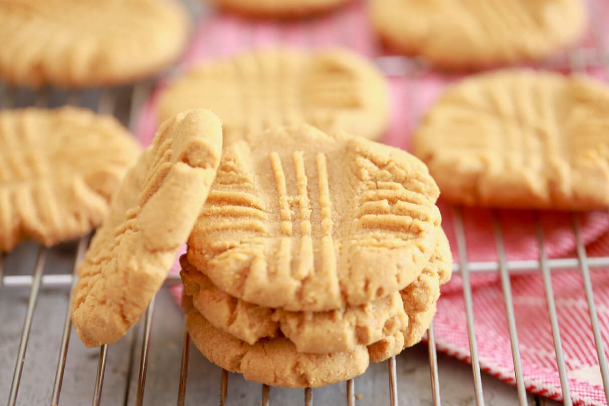 3 Ingredient Peanut Butter Cookies recipe stacked up on a wire rack.