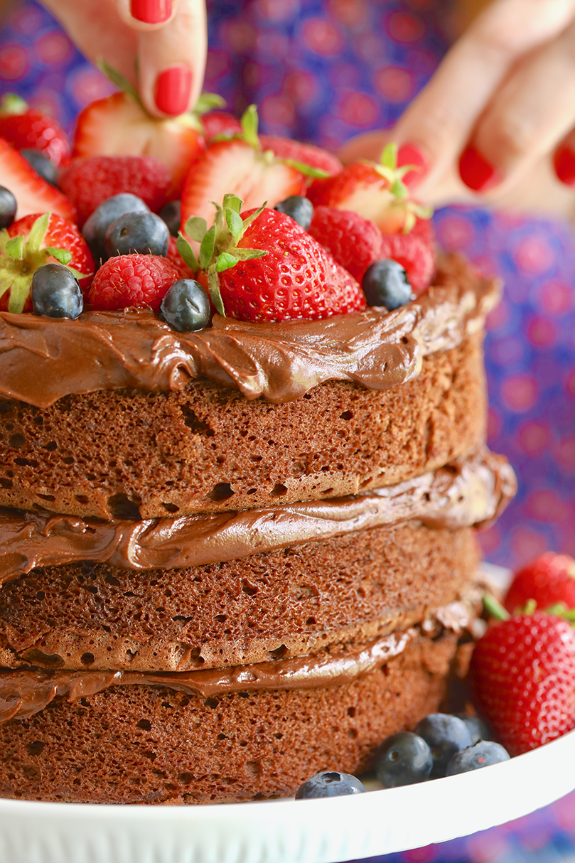 An easy chocolate cake with fruit on top.