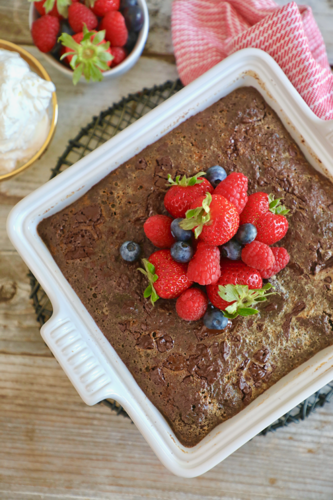 Brownie bread pudding, topped with fresh berries.