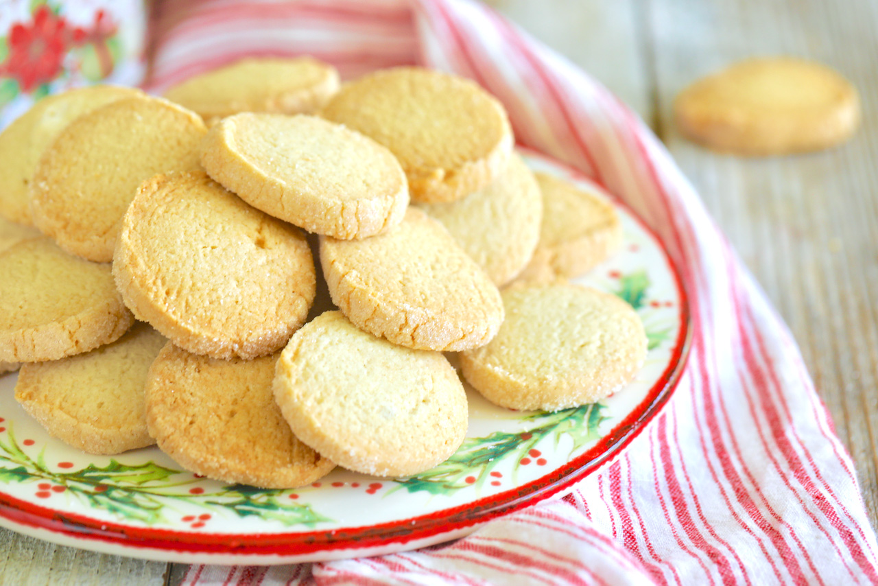 A pile of gluten free sugar cookies, perfectly baked and ready to eat.