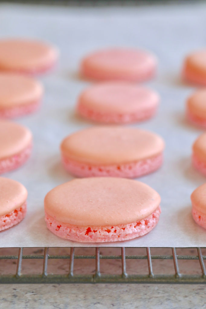 Pink macarons baked avoiding the 7 macaron mistakes everyone makes, showing feet and texture.