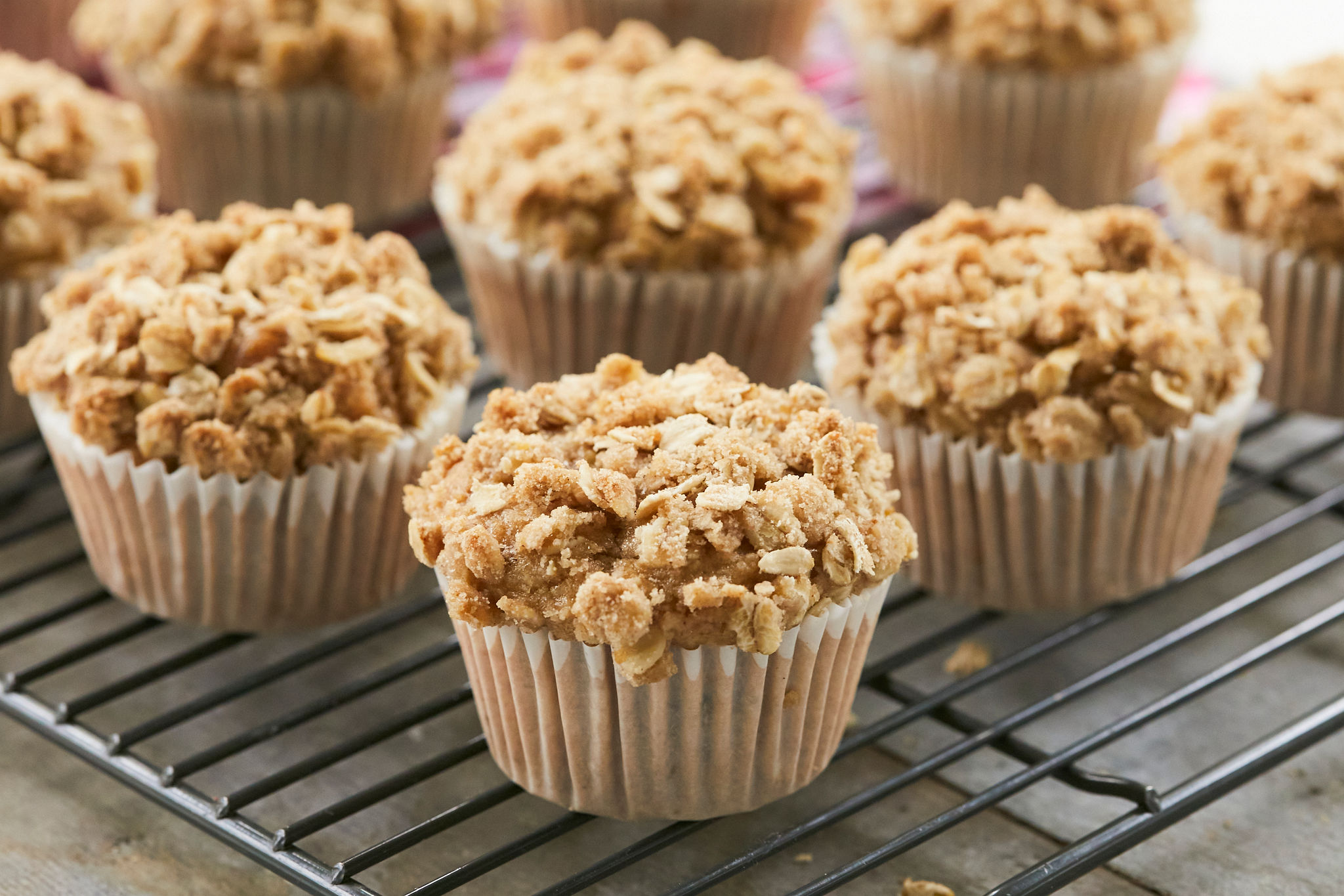 Banana Nut Muffins arranged and topped with streusel.