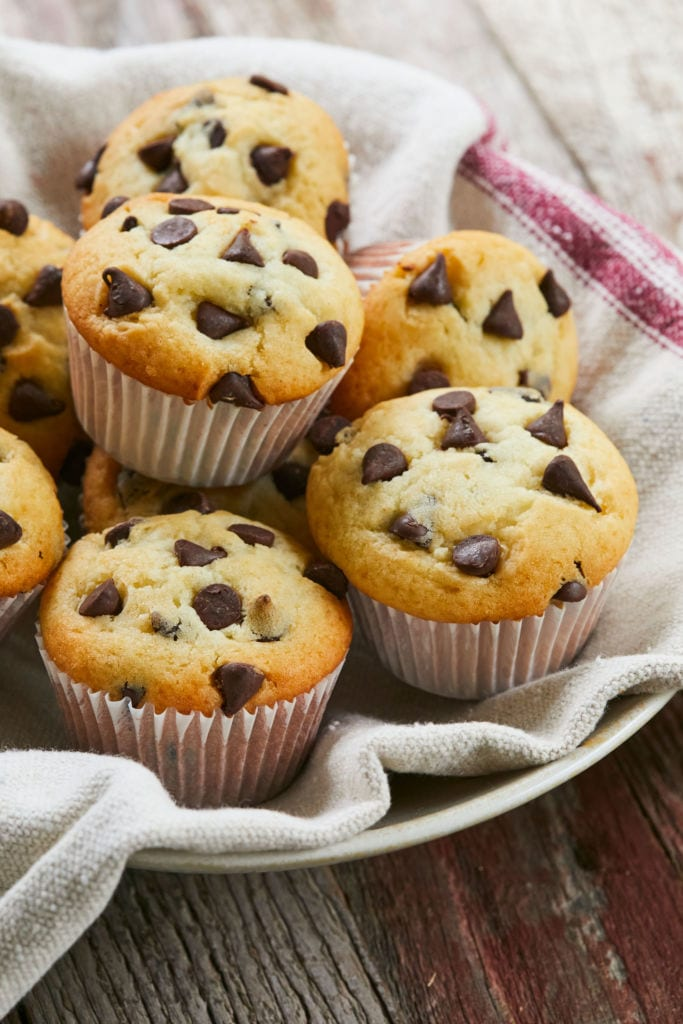 A bowl full of Classic Chocolate Chip Muffins.