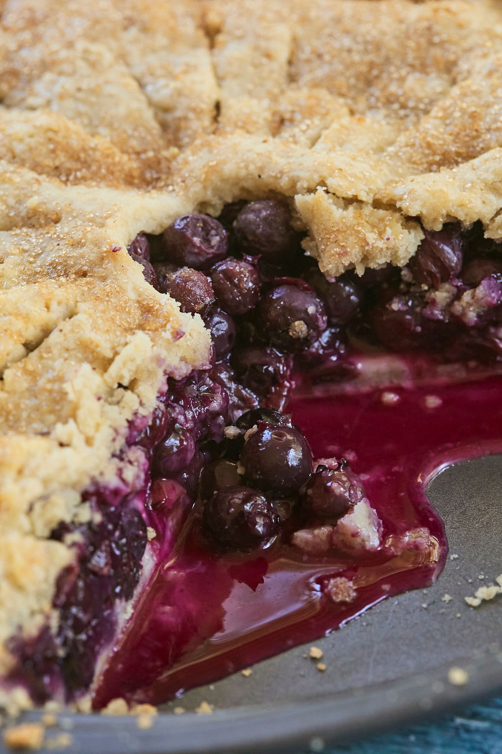 A close of of my Blueberry Pie recipe, showing the crust, blueberries, and juice.