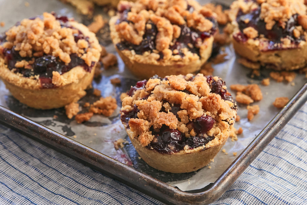 Blueberry Crumb Pies on a Baking Tray.