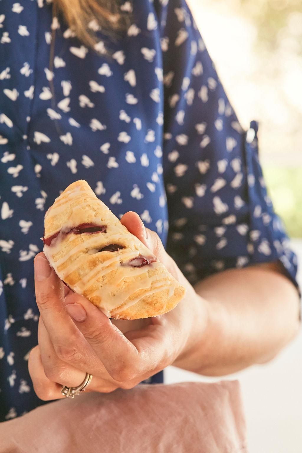 Gemma Stafford holding her Cherry Hand Pie.
