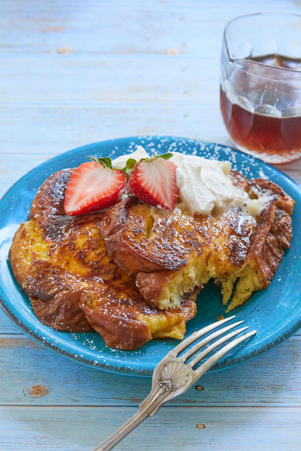 Topped with cream and berries, this Brioche French Toast recipe was too good not to take a bite.