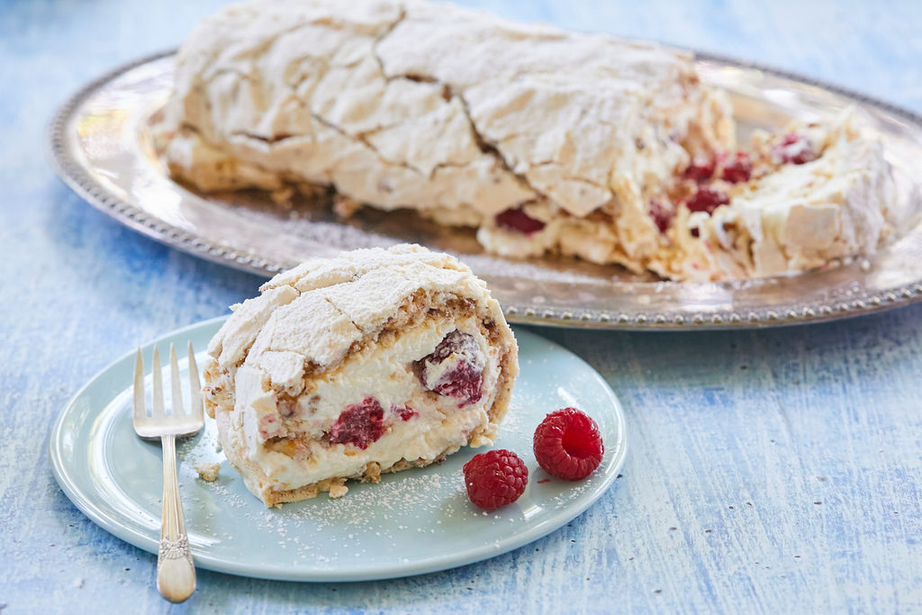 Hazelnut and Raspberry Roulade served on a dish.