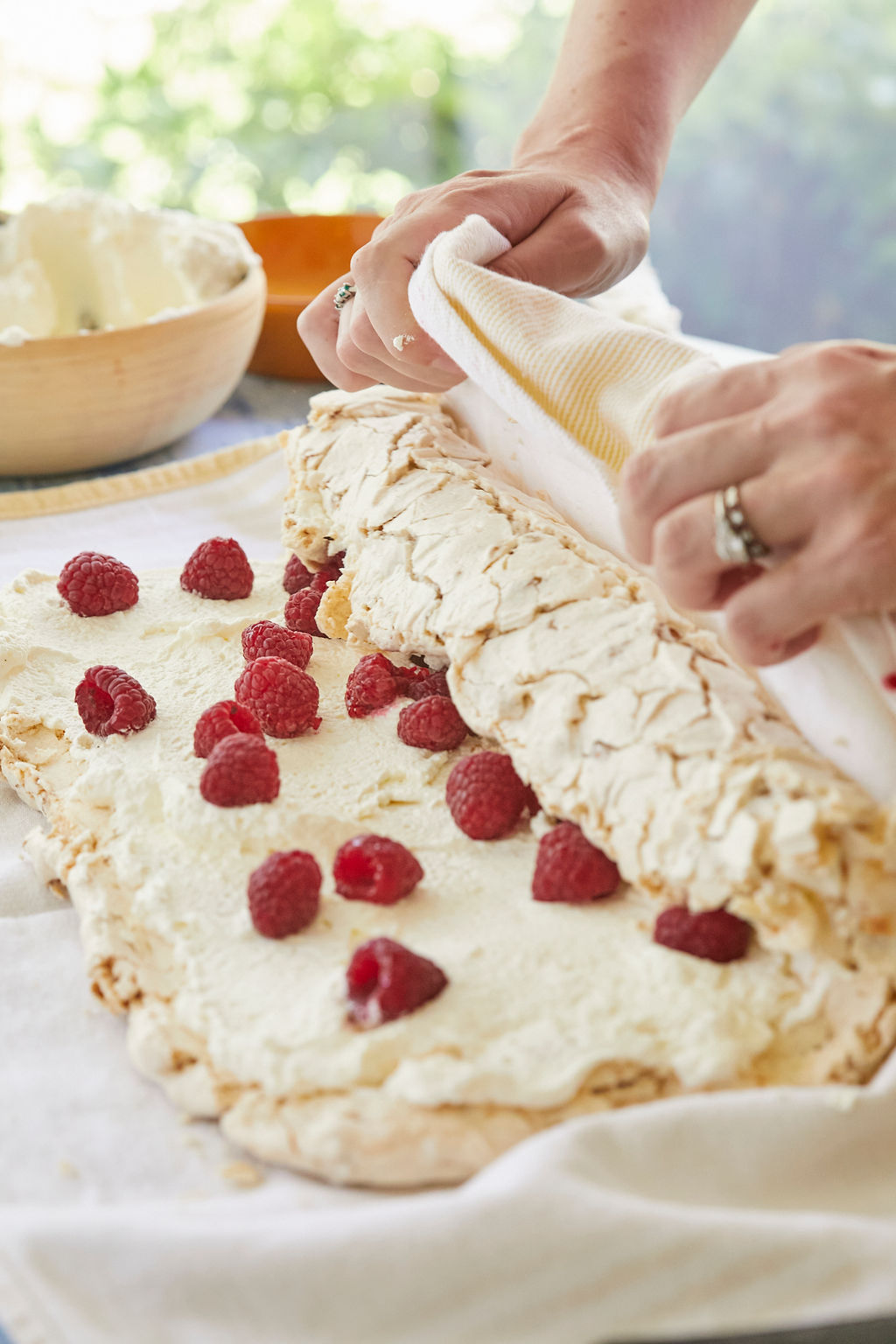 A close up of the technique to roll my Hazelnut and Raspberry Roulade