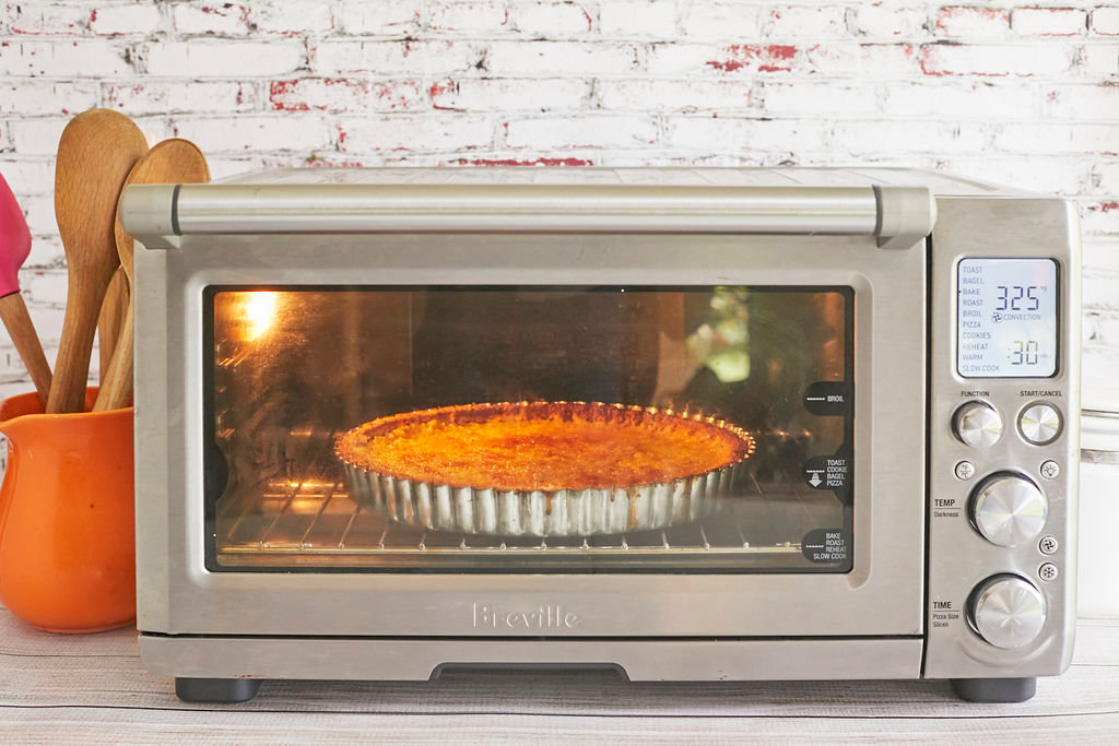 An OTG, also known as a toaster oven, baking a dish.