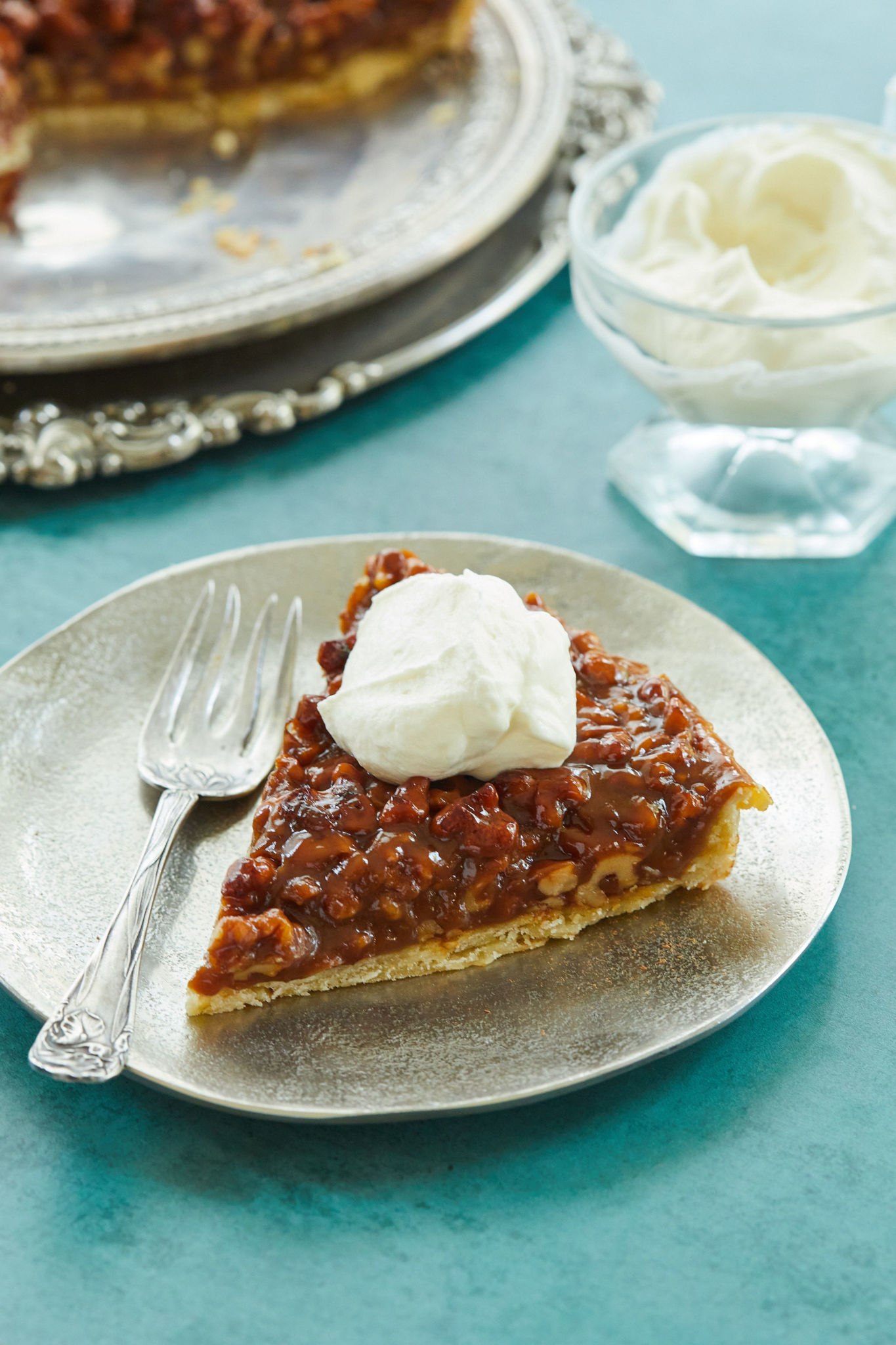 A slice of my walnut caramel tart, topped with whipped cream.