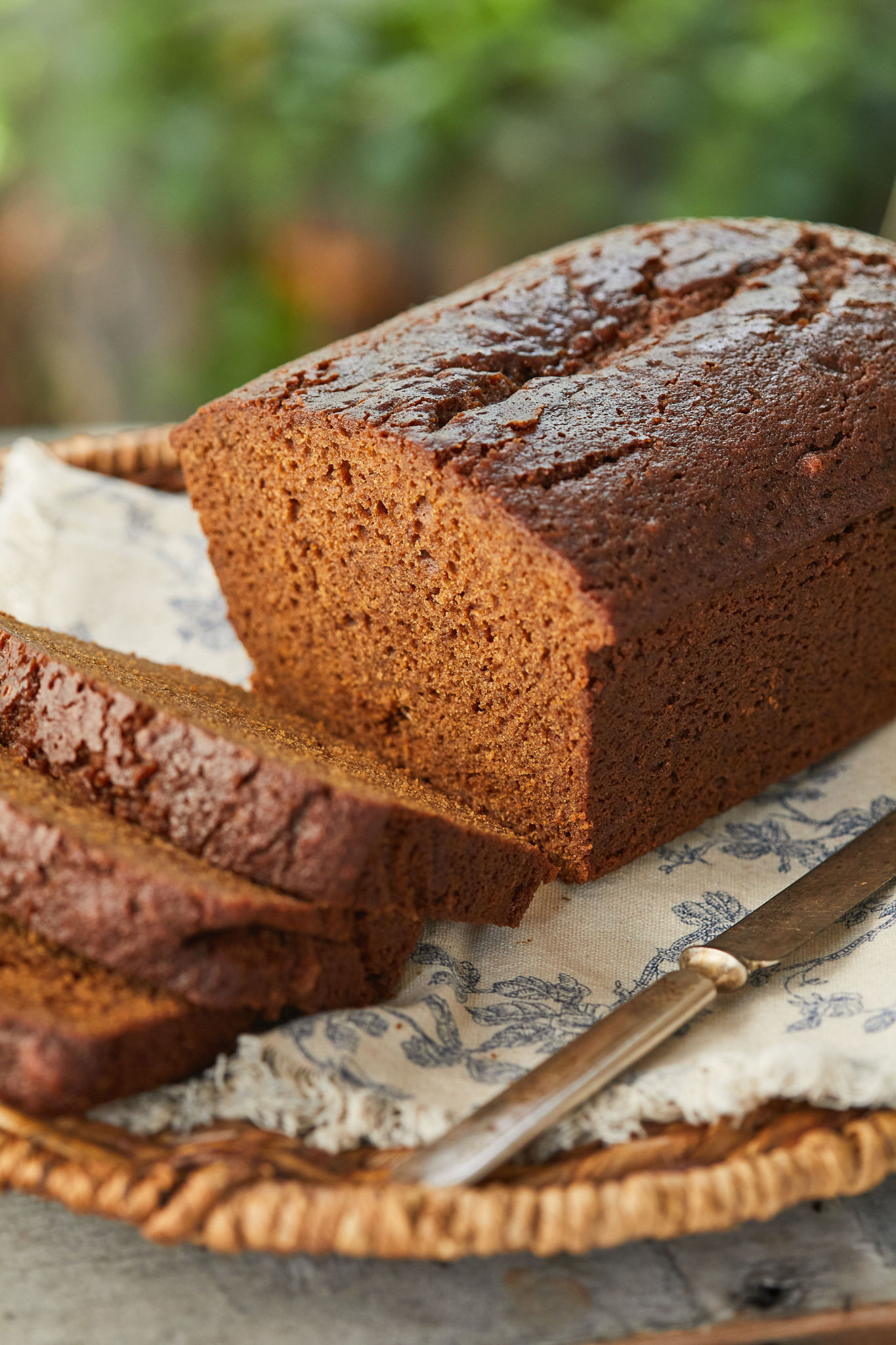 Warm, spiced, Sticky Gingerbread, sliced.