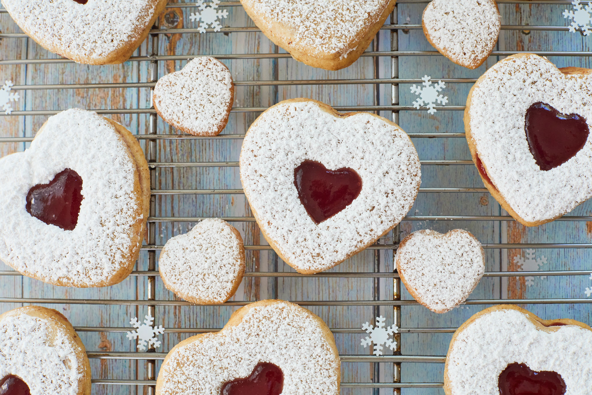 Top-down view of Linzer cookies with heart cutouts.