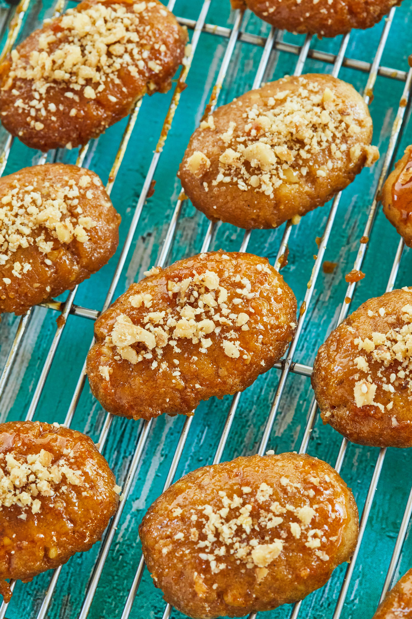 Sticky Greek Honey Cookies on a cooling rack.