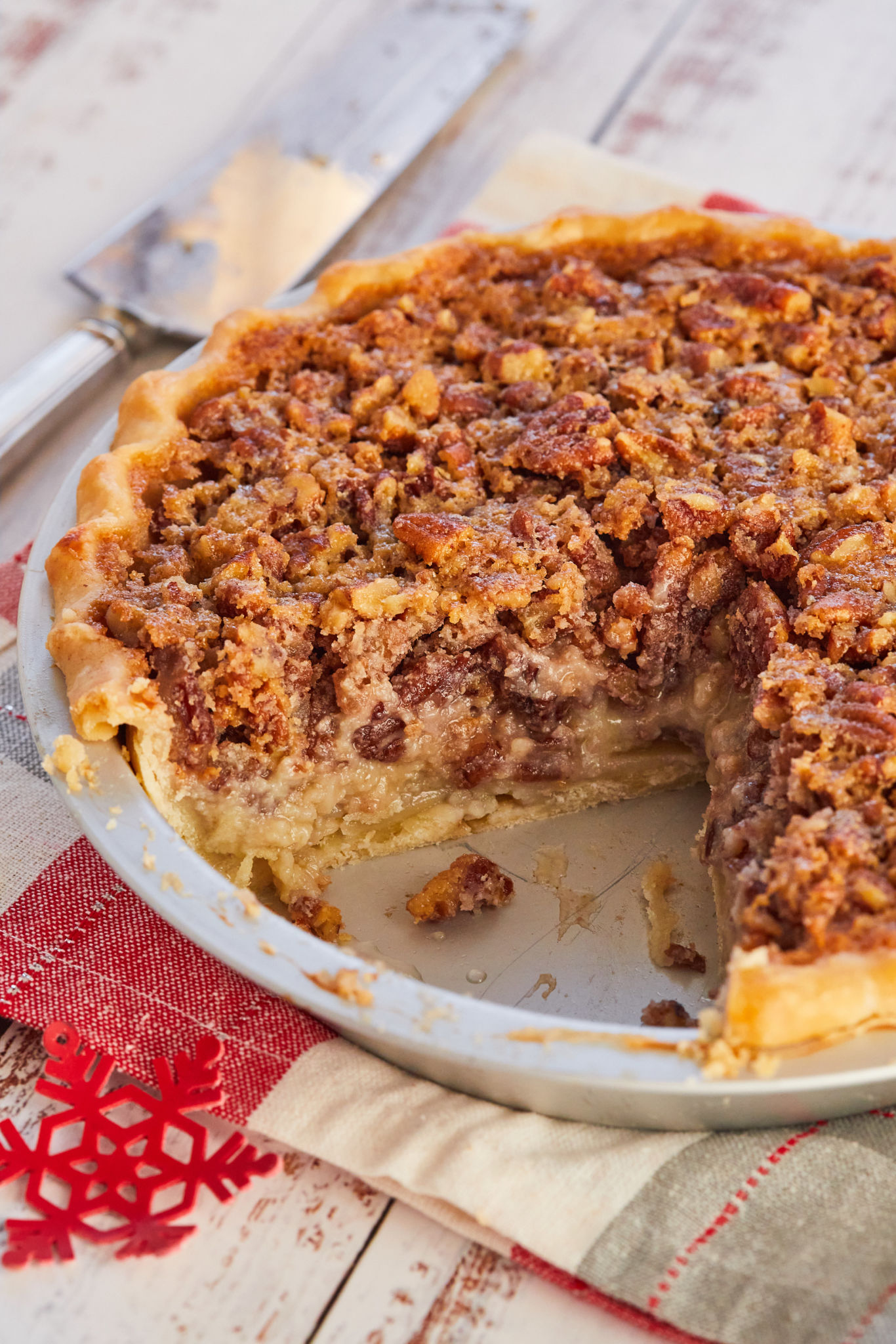 An American Buttermilk Pecan Pie with a slice cut out of it.