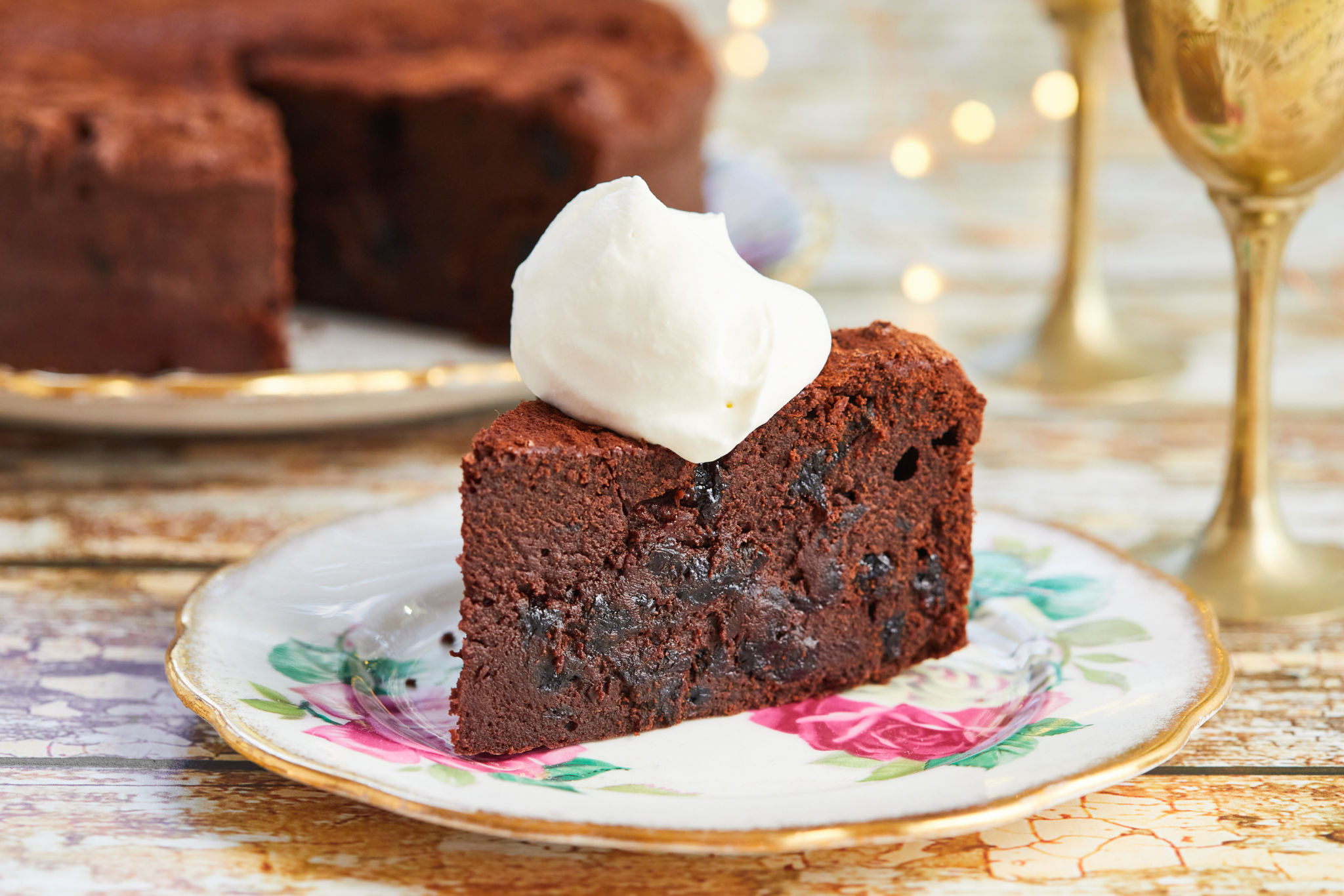 A slice of my Warm Chocolate Cake with Rum-Soaked Prunes with whipped cream on top!