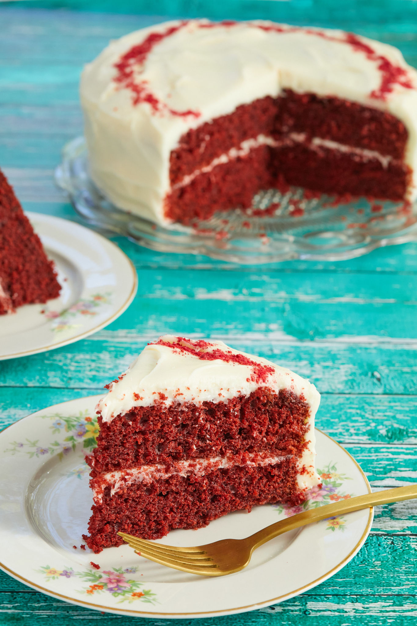 A slice of my moist Best-Ever Red Velvet Cake recipe, topped with ermine frosting.