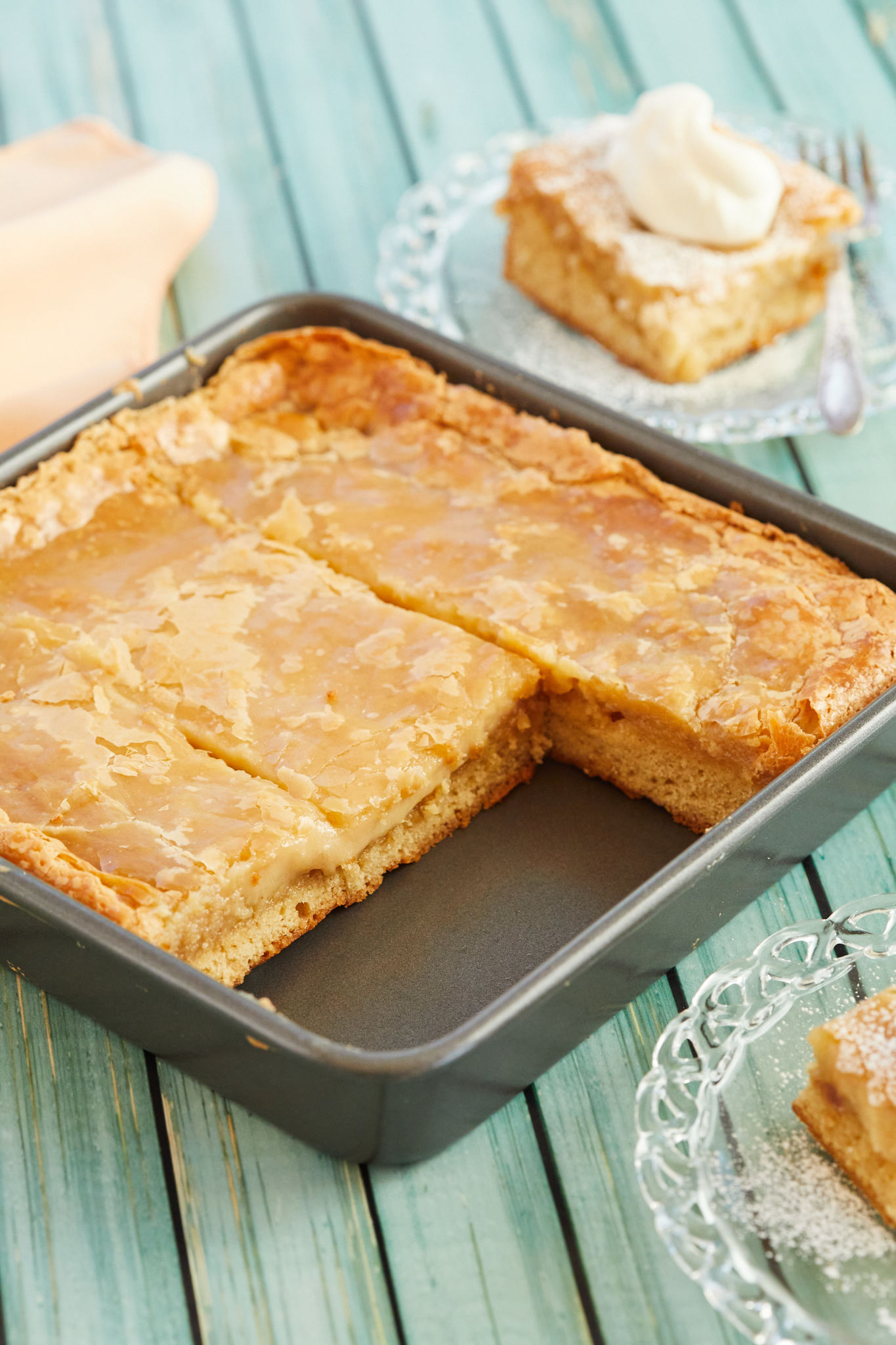 A tray of my Gooey Butter Cake recipe, with slices removed.