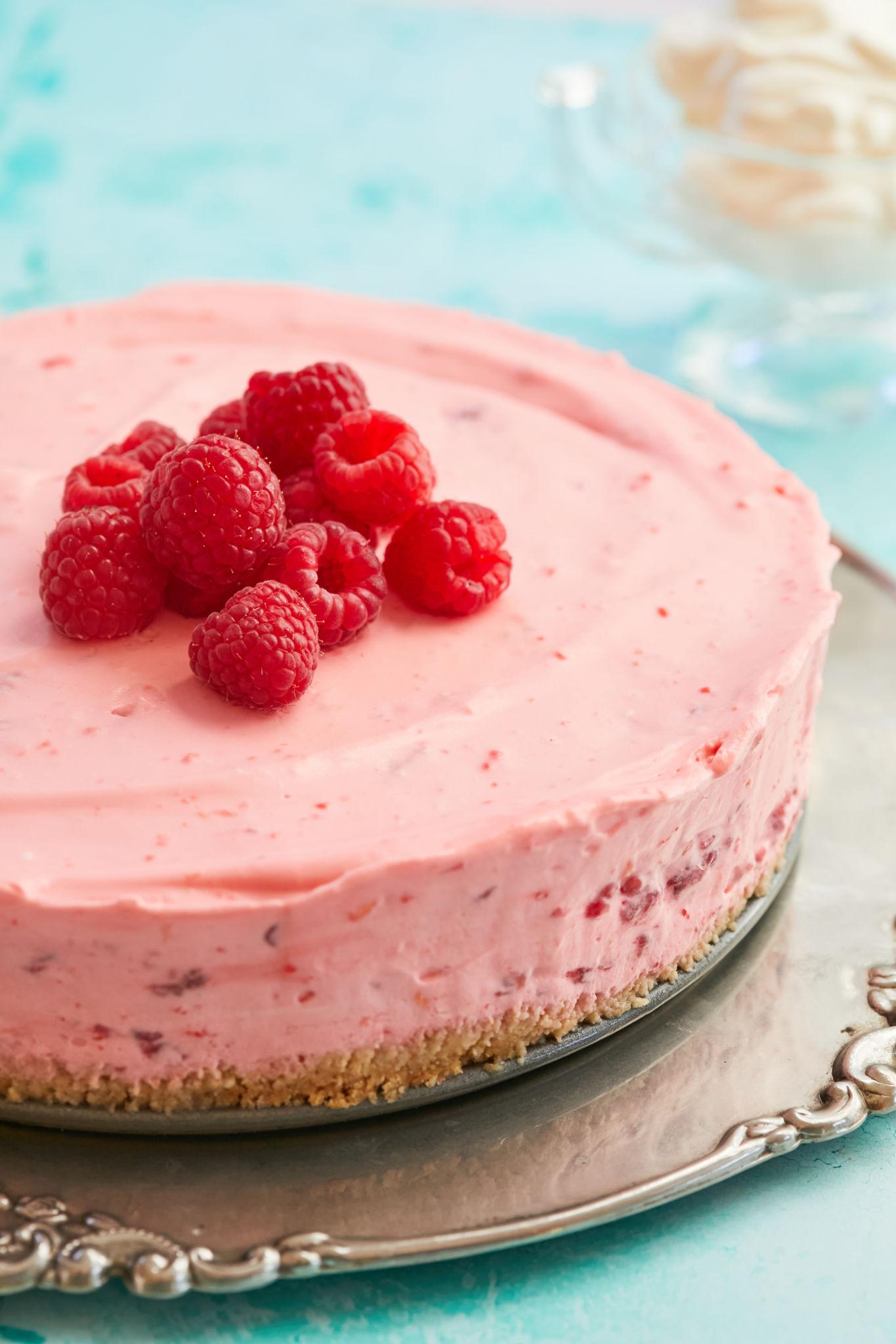 My No-Bake Raspberry Cheesecake, topped with raspberries.