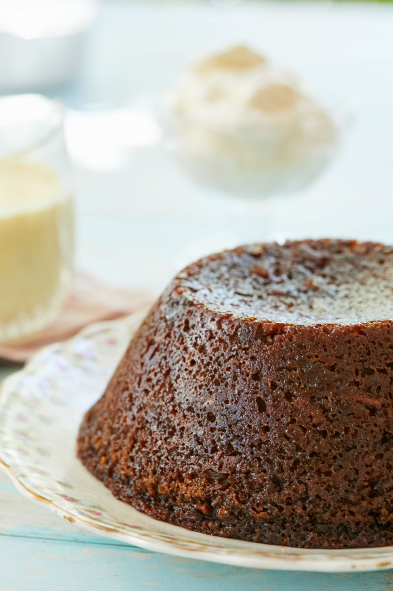 A close up of steamed carrot cake pudding, a very moist carrot cake.