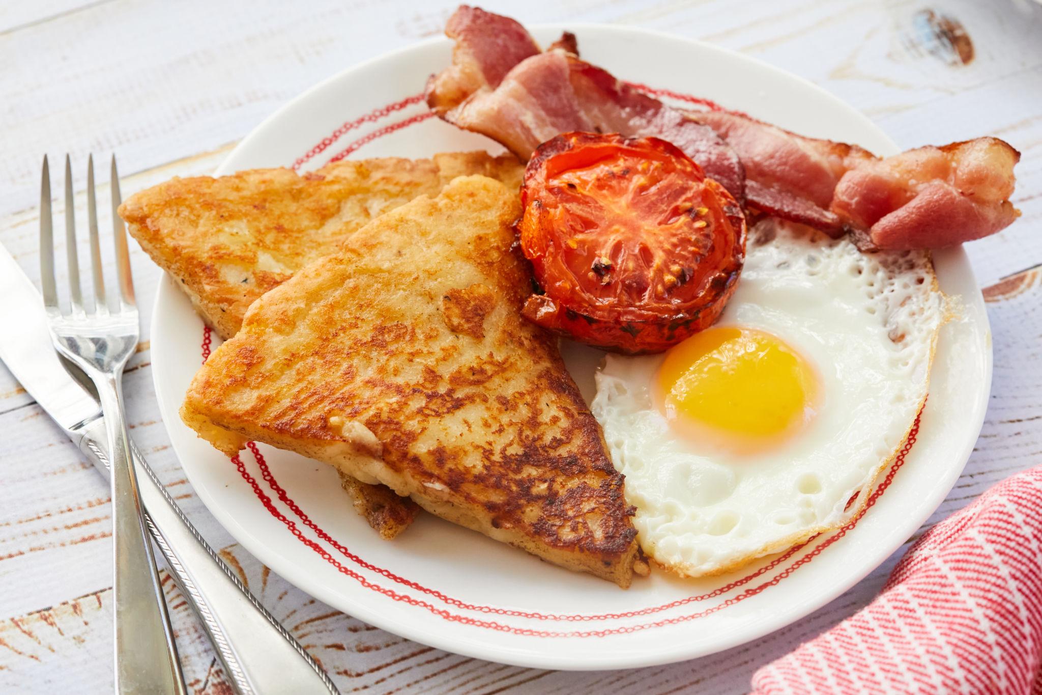 Potato Farls, also known as Potato Cakes, with eggs, bacon, and tomatoes.