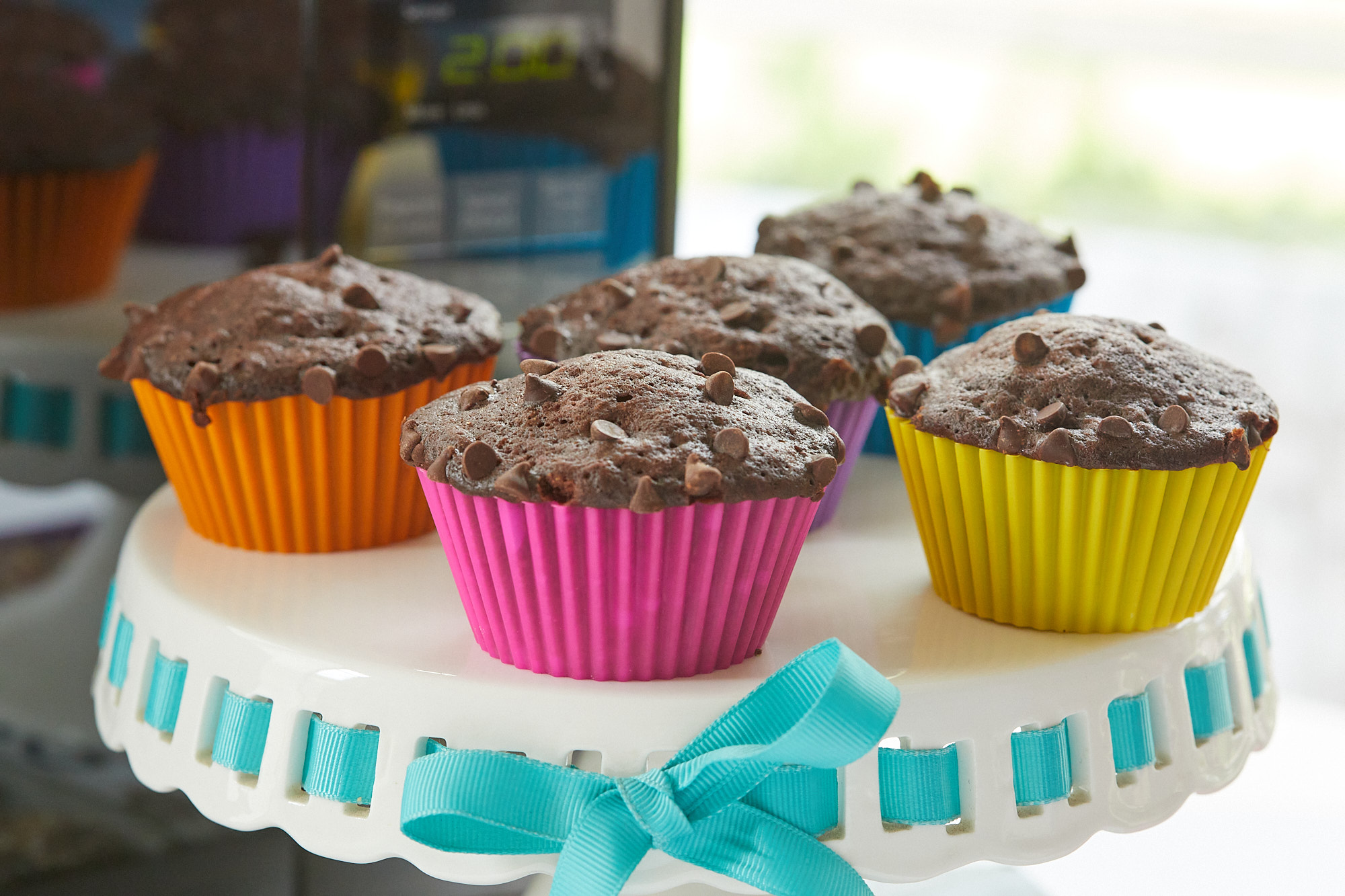 Five microwave chocolate muffins on a platter.