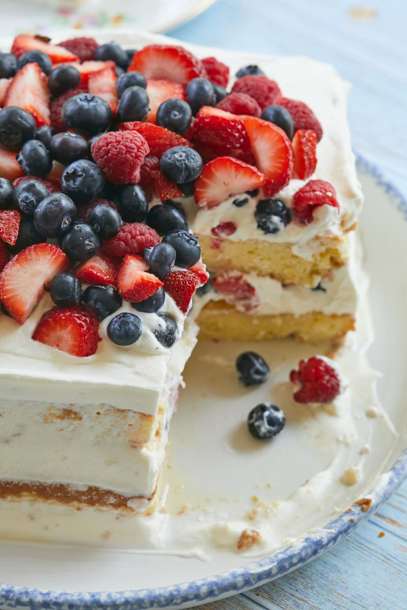 A Milk'N Berries Cake with a slice removed.