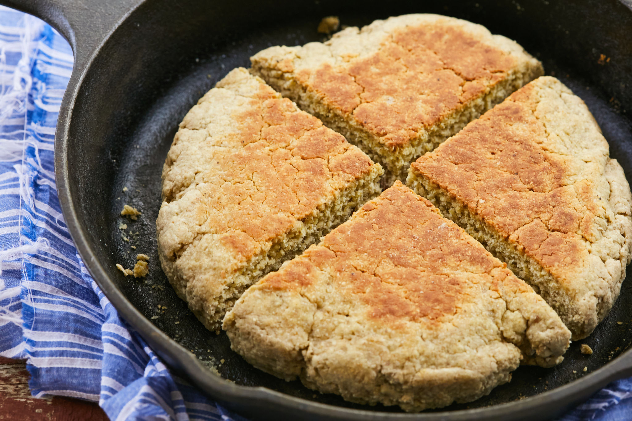 Scottish Bannock cut into four in the cast iron pan.
