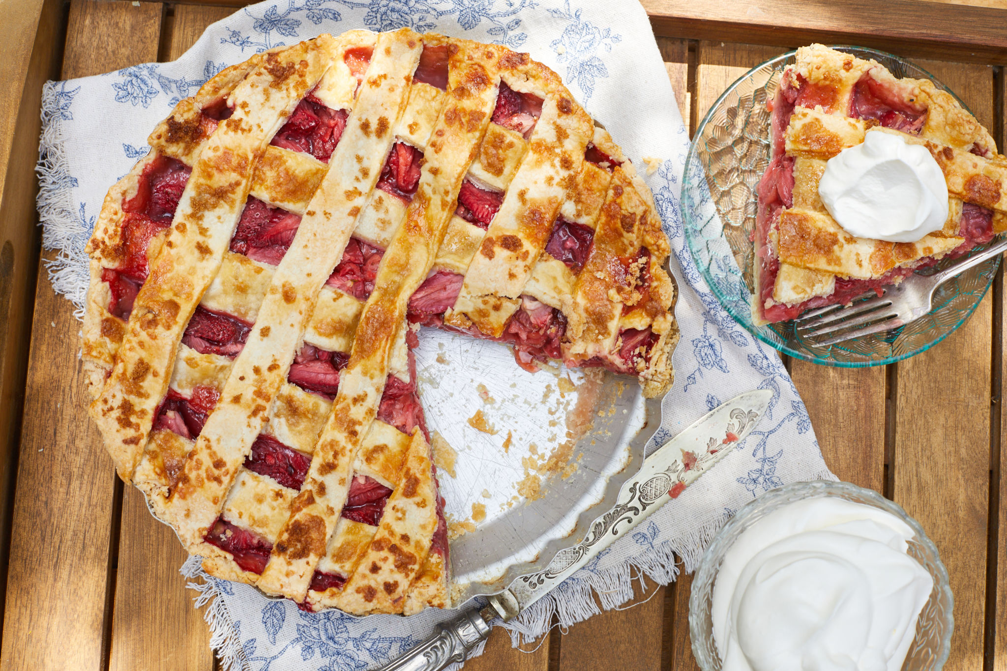 A strawberry pie with a piece removed.