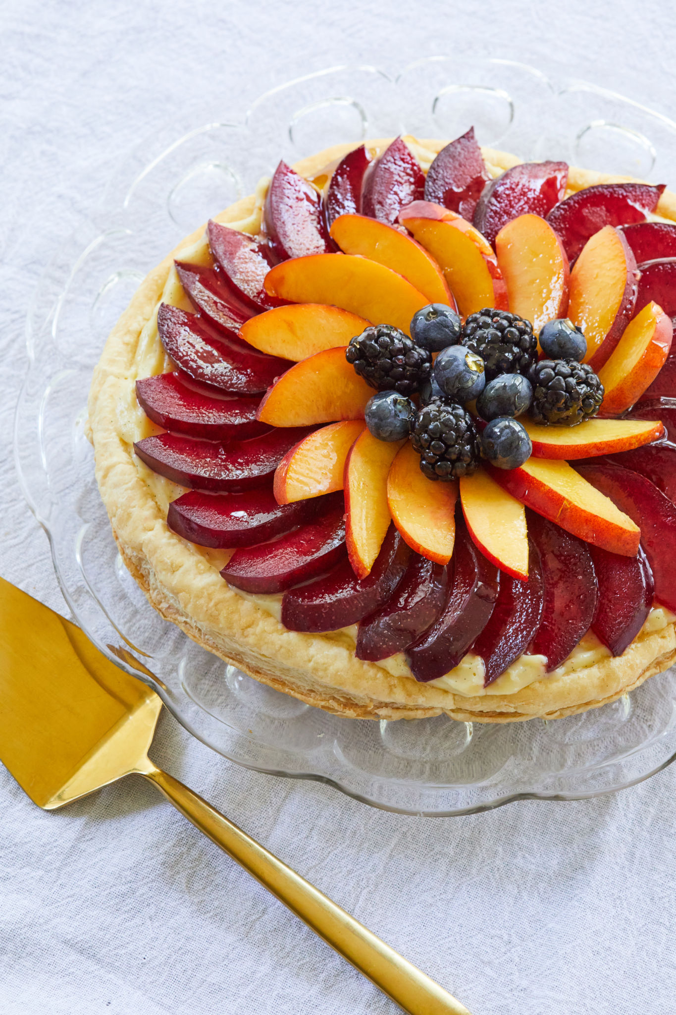 A summer fruit tart recipe topped with fruit.